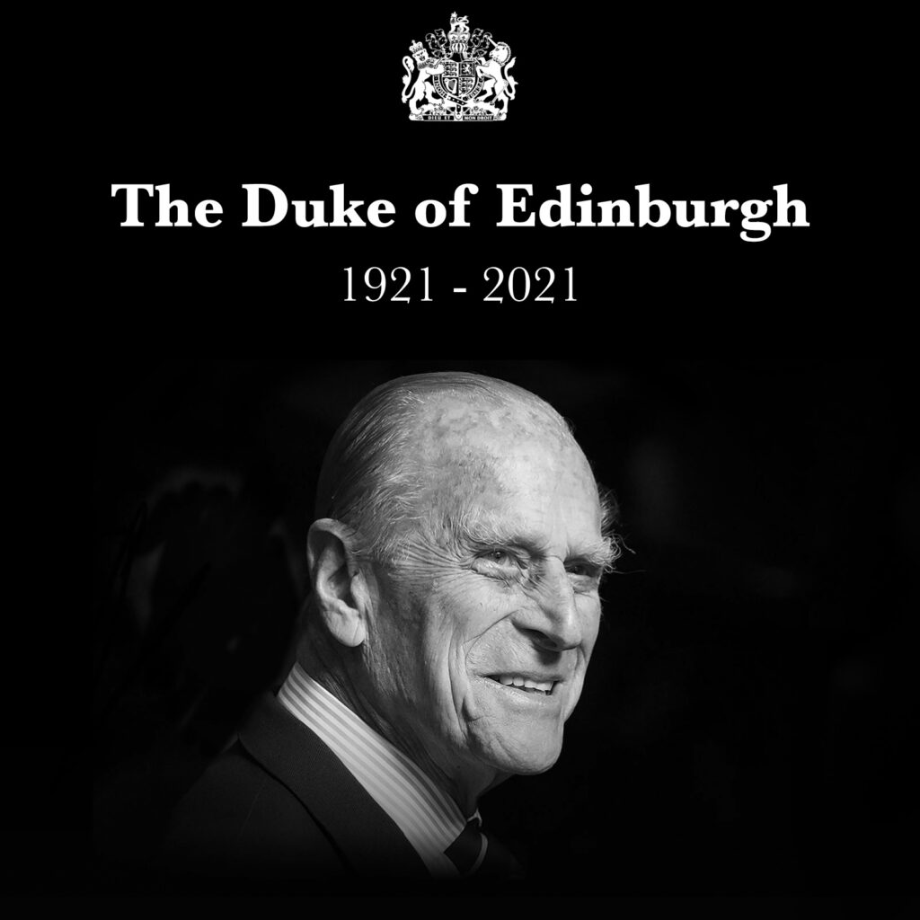 Black and white photograph of the Duke of Edinburgh with his title in white text with the royal crest and the dates 1921 - 2021